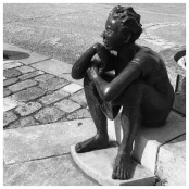 public art, Chauvigny, boy on steps, sculpture